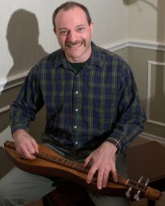 Mark Gilston plays a mountain dulcimer