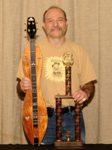 Mark Gilston with winning trophy and prize dulcimer at Winfield 2016